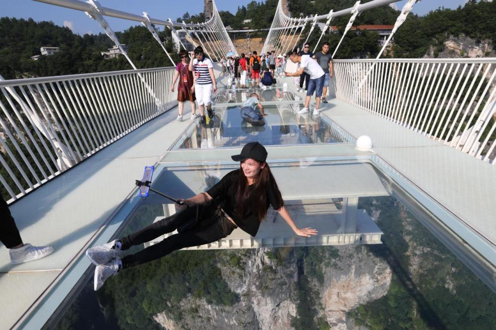 <p>Cameras and selfie sticks are banned although many tourists seem to already be defying the rules. (Getty Images)</p>