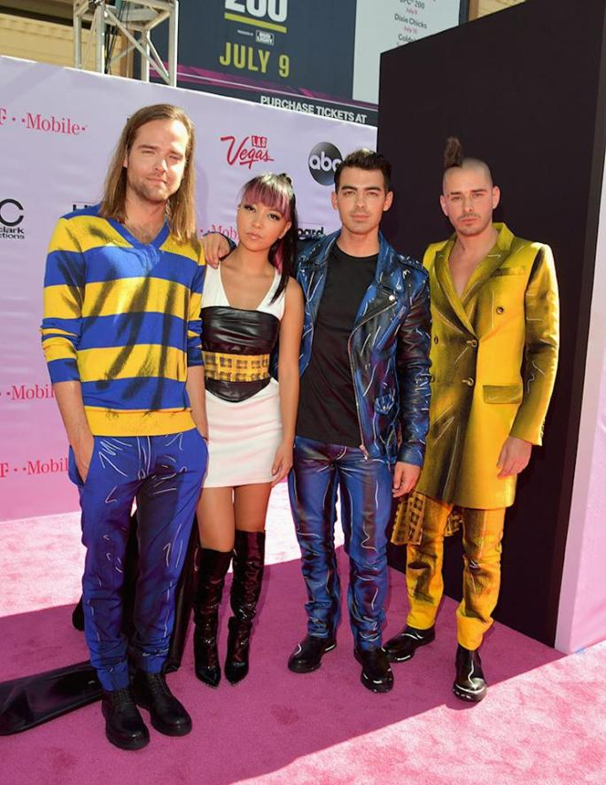 """<p>Joe Jonas's new band, DNCE, has gotten <a href=""""https://www.yahoo.com/beauty/joe-jonas-gets-kudos-for-new-video-costar-not-a-185527906.html"""">major kudos</a> for its new video """"Toothbrush,"""" but tbh, we're still singing """"Cake by the Ocean."""" They opted for a coordinated look for the pink carpet.<i>(Photo: Lester Cohen/Getty Images)</i></p>"""