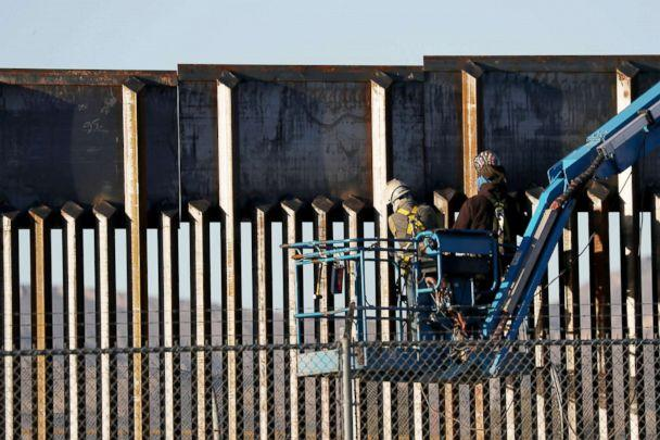 PHOTO: People work on the U.S./Mexican border wall, Feb. 12, 2019, in El Paso, Texas. (Joe Raedle/Getty Images)