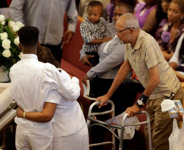 The Latest: Church fills at funeral for 4 killed in sinking