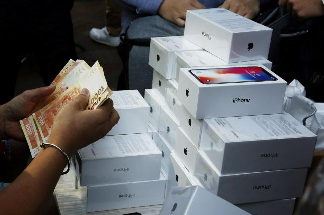 Apple breaches $1 trillion stock market valuation