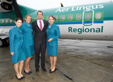 File: Fine Gael Minister for Transport, Tourism and Sport Leo Varadkar with Aer Lingus Regional cabin crew members (from left) Kitty Dillon, Melanie Fitzgerald and Claire Lacey