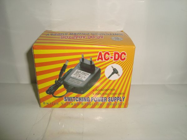 AC-DC Adaptor 12V/2A (Switching Power Supply) Cocok Untuk Receiver Parabola Orange TV dan K-vision