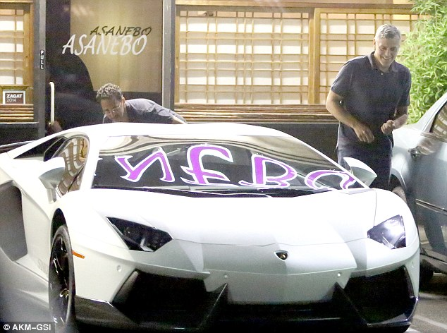 George Clooney Checks Out A Lamborghini Preparing For The