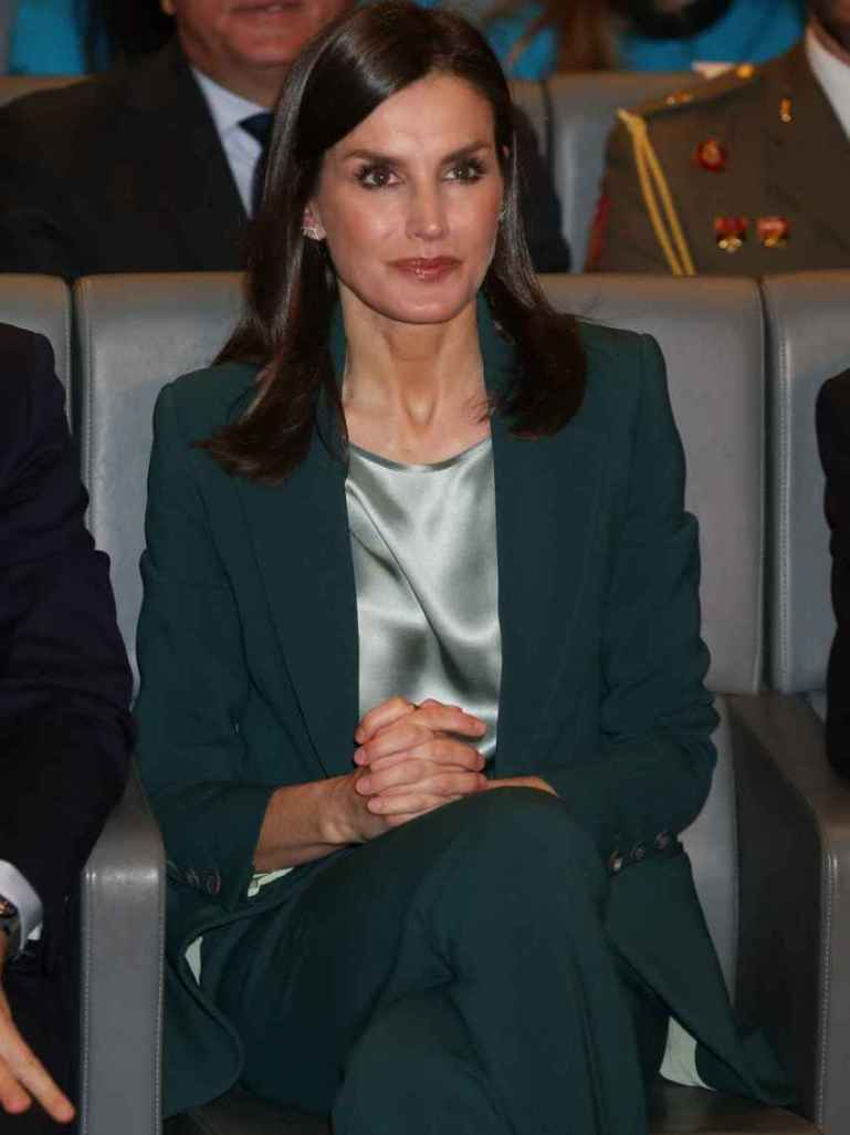 Letizia, wearing a Hugo Boss trouser suit and jacket, which debuted in February.