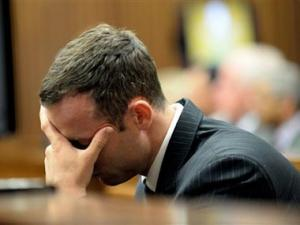 Pistorius vomits as graphic details of Steenkamp injuries revealed