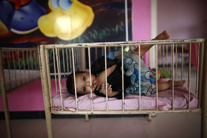 "A baby girl is seen lying in a cradle inside the Life Line Trust orphanage in Salem in the southern Indian state of Tamil Nadu June 20, 2013. These unwanted infant girls in southern India's Tamil Nadu state are considered the fortunate ones. They are India's ""Cradle Babies,"" products of a government scheme that permits parents to give their unwanted baby girls anonymously to the state, saving them from possible death in a region where daughters are seen as a burden and where their murder is a common reality. Picture taken June 20, 2013. To match INDIA-CRADLEBABIES/ Thomson Reuters Foundation/Mansi Thapliyal (INDIA - Tags: SOCIETY) - GM1E9C318AJ01"