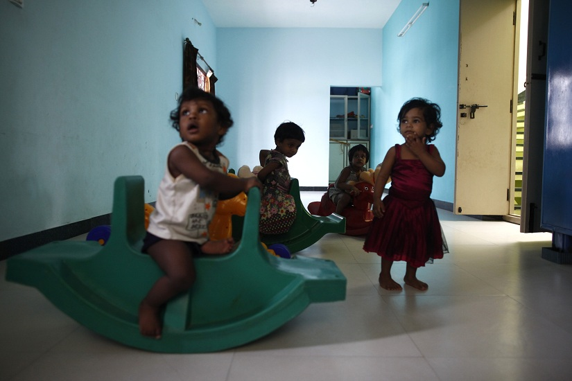 "Baby girls play inside the Life Line Trust orphanage in Salem in the southern Indian state of Tamil Nadu June 20, 2013. These unwanted infant girls in southern India's Tamil Nadu state are considered the fortunate ones. They are India's ""Cradle Babies,"" products of a government scheme that permits parents to give their unwanted baby girls anonymously to the state, saving them from possible death in a region where daughters are seen as a burden and where their murder is a common reality. Picture taken June 20, 2013. To match INDIA-CRADLEBABIES/ Thomson Reuters Foundation/Mansi Thapliyal (INDIA - Tags: SOCIETY) - GM1E9C3185901"