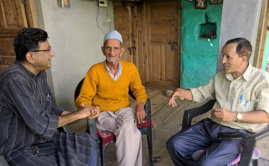 Dhyan Singh Rawat with Molda village patriarch. Image credit: S Giridhar