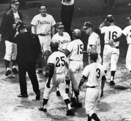 Allen being greeted at home plate after powering the Phillies to a walk-off win the late 60s.