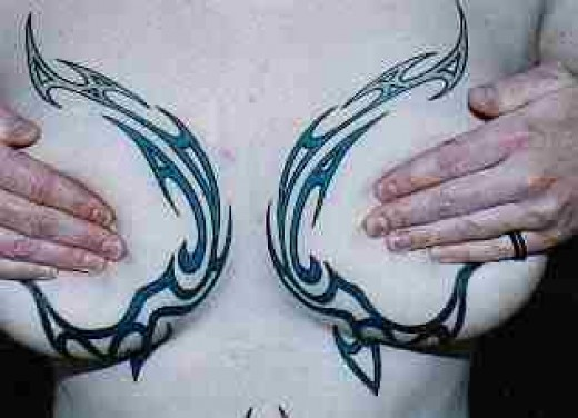 power tattoos on the breast sides!