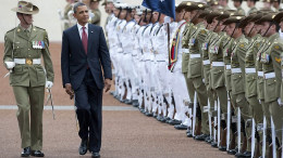 Obama walks past an honor guard on his arrival to Parliament House in Canberra