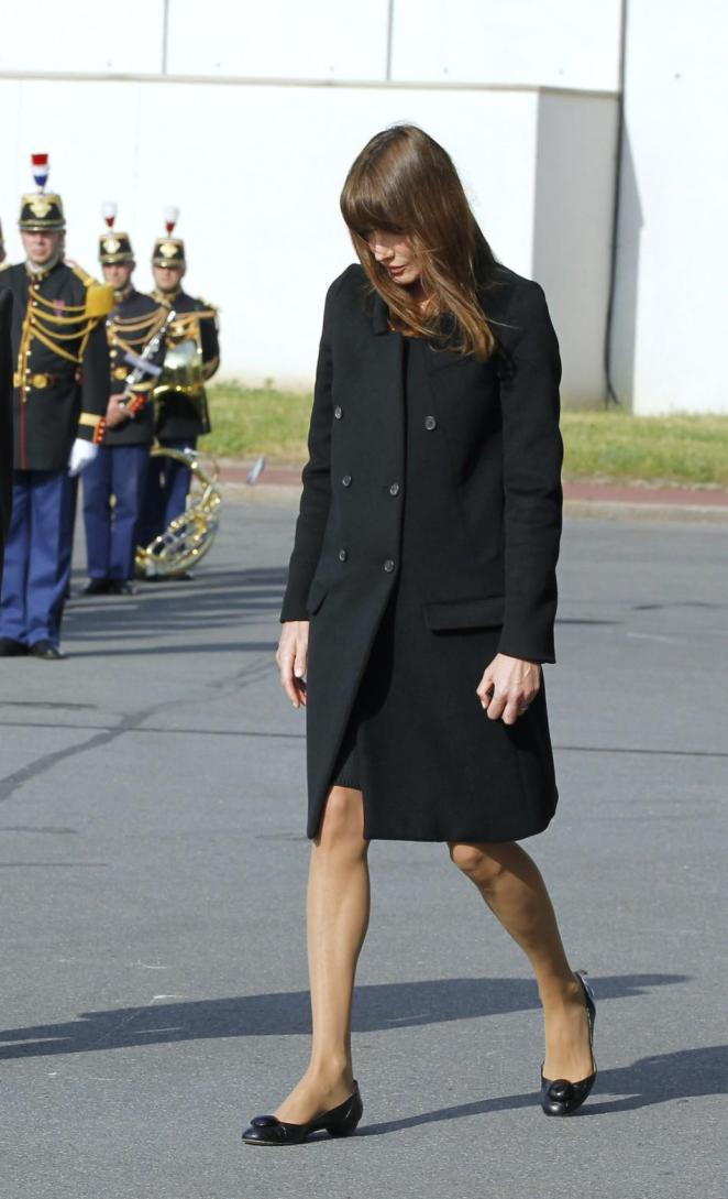 France's First Lady Carla Bruni-Sarkozy arrives to attend a ceremony at Orly airport in memory of the eight French citizens who were killed in a bomb attack at cafe in Marrakesh