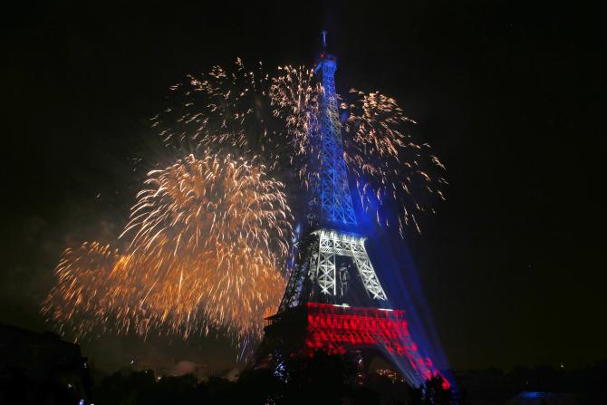 Eiffel Tower in the French national colors, backlit by fireworks, on Bastille Day 2014. IBTimes photo