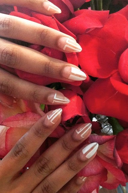 A Customer Chooses Good Match To Touch Up Her Nails Walking In The Door Customers Are Often Greeted With Pick Color Credit Nicole Bengiveno