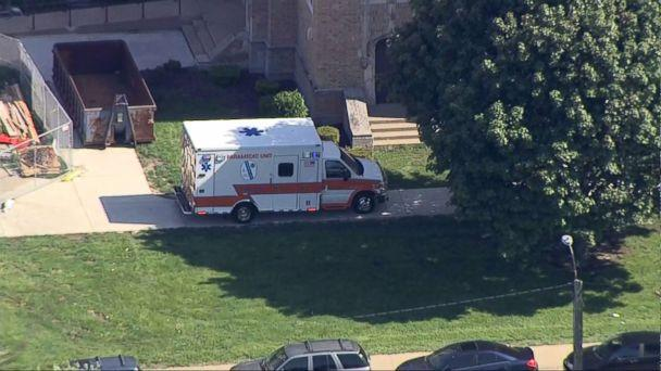 PHOTO: An ambulance sits in front of Dixon High School in Dixon, Ill., after a police officer confronted and injured an armed man at the school, May 16, 2018. (WLS)