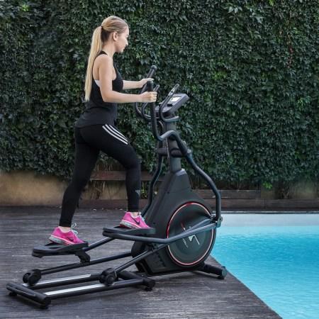 Bicicleta eliptica fitness TECHFIT FW700, Volanta frontala 12 kg, Greutate utilizator 130 kg, Roti pentru transport