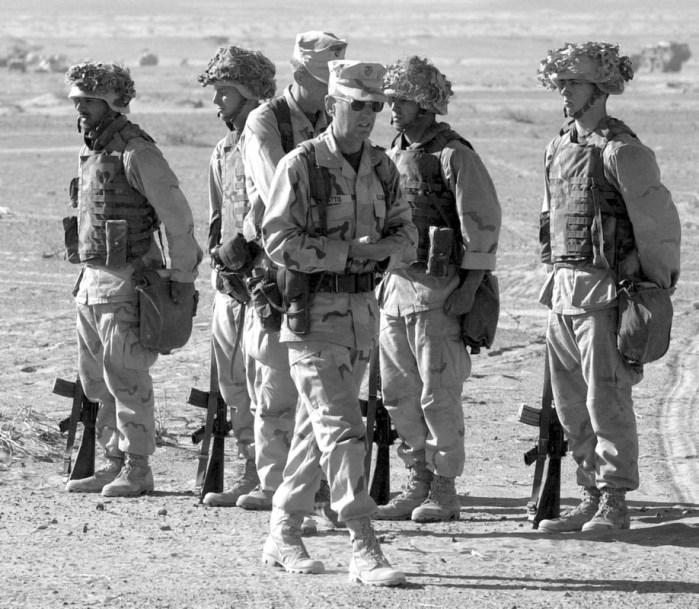 Jim Mattis walks past an honor guard as he arrives