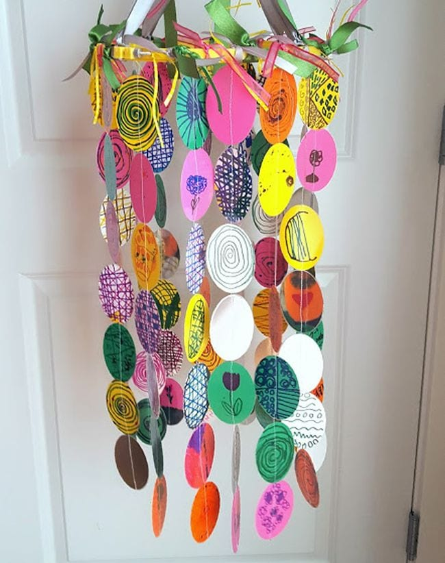 Mobile made of a variety of paper circles in different colors and patterns (First Grade Art Project)
