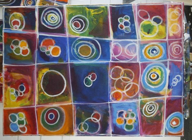 Canvas divided into squares, with different circle patterns and colors in each