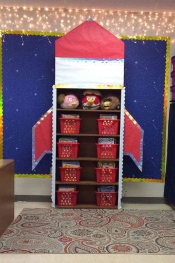 Red and white rocket ship classroom shelving organizer with baskets