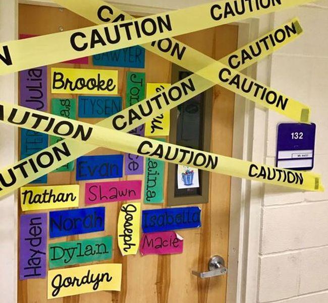 School room doorway crisscrossed with caution tape (Classroom Escape Room)