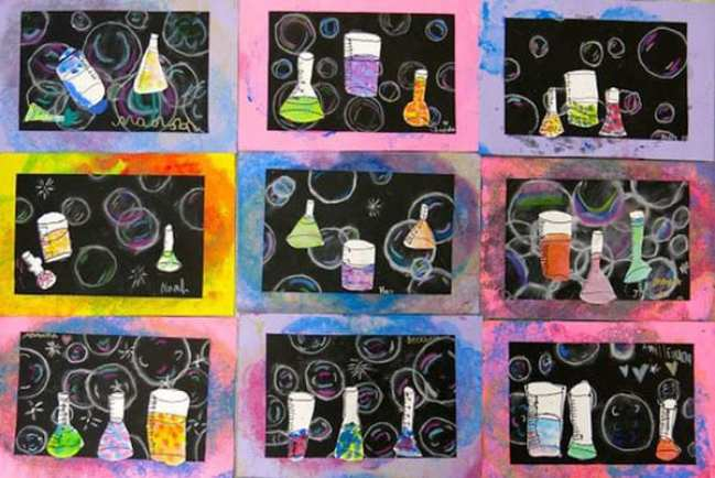 Mixed media first grade art projects showing chalk bubbles and paper beakers painted in various patterns