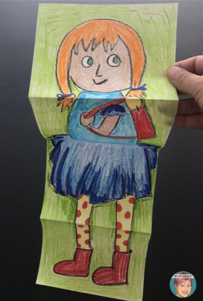 Crayon drawing of a child on a long piece of paper folded in quarters (First Grade Art)
