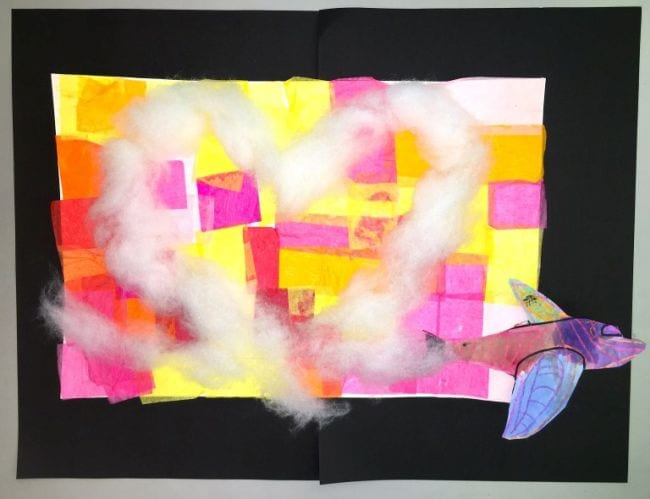 Colorful paper plane flying over a tissue paper background, leaving a heart made of cotton behind (First Grade Art Projects