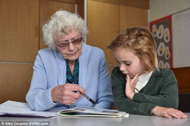 A photo of Britain's oldest teacher with a young student -- teaching a long time