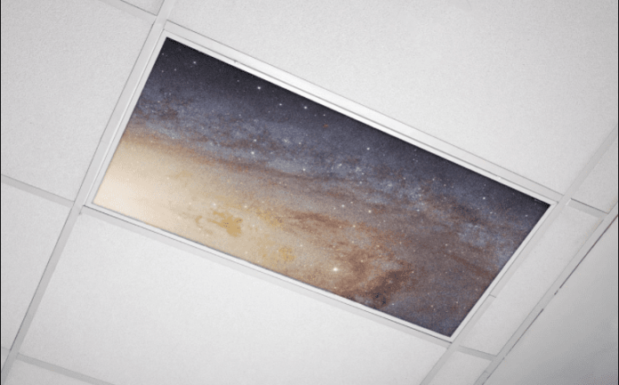 Space themed fluorescent light cover in classroom ceiling