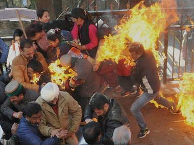 Image result for protesting against modi who burned