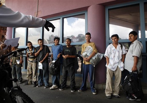 A group of illegal immigrants listen to a Border Patrol agent while being deported to Mexico at the Nogales Port of Entry in Nogales, Ariz.