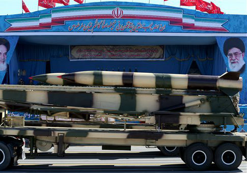 A missile is displayed during a military parade in Tehran / AP