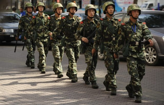 Chinese paramilatary police patrol on a street in Urumqi, capital of China's Xinjiang region