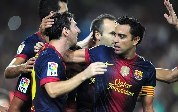 Messi, Xavi e Iniesta, Barcelona x Real Madrid (Foto: Agência AFP)