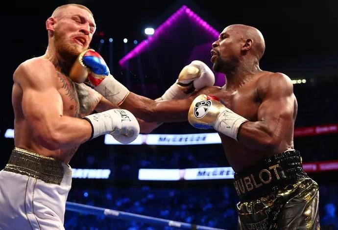 Resultado de imagem para Mayweather nocauteia Conor McGregor depois de dez rounds