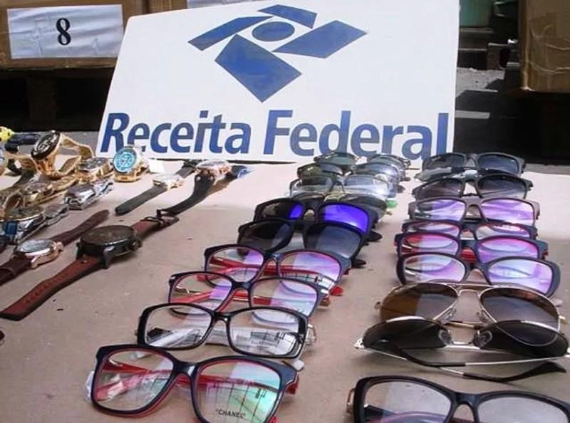 Produtos foram analisados pelos fiscais, que constataram a falsificação (Foto: Divulgação/Receita Federal)