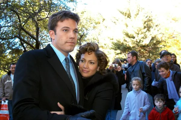 """UNITED STATES - NOVEMBER 07: Jennifer Lopez embraces Ben Affleck in an off-camera love scene in Central Park, where they were filming their new flick, """"Jersey Girl."""" Lopez, reportedly due to announce her engagement to Affleck soon, snuggled up to Ben aft (Photo: NY Daily News via Getty Images)"""