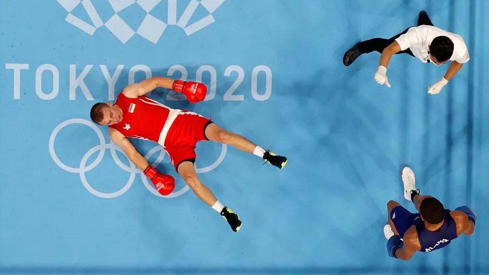 Hebert Conceicção nocauteia o ucraniano é campeão olímpico — Foto: Ueslei Marcelino/Reuters