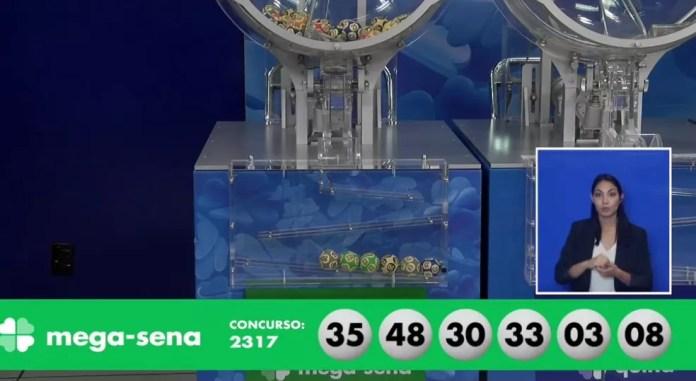 Números sorteados no concurso 2.317 da Mega-Sena — Foto: Reprodução/Caixa