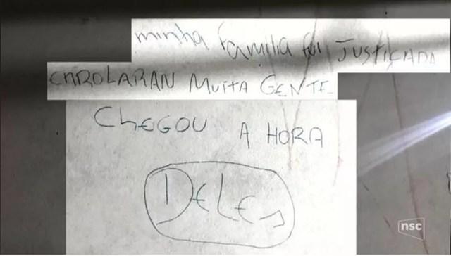 Criminosos deixaram recado em parede no local do crime (Foto: reprodução NSC TV)