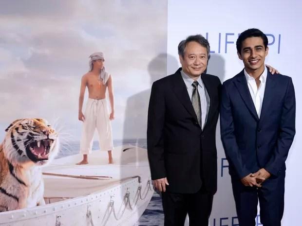 Cineasta Ang Lee e ator Suraj Sharma em estreia de 'As aventuras de Pi' em 16 de novembro na cidade de Los Angeles (Foto: Phil McCarten/Reuters)