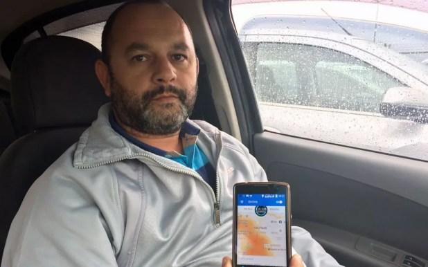 Luiz Moura, motorista de Uber em São Paulo (Foto: Tatiana Santiago/G1)