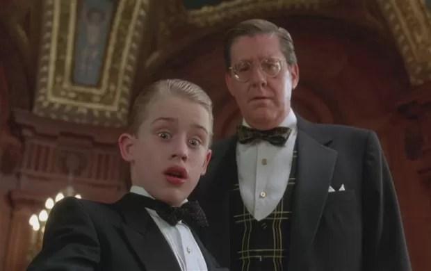 Macaulay Culkin e Edward Herrmann em cena de 'Riquinho' (1994) (Foto: Divulgação)