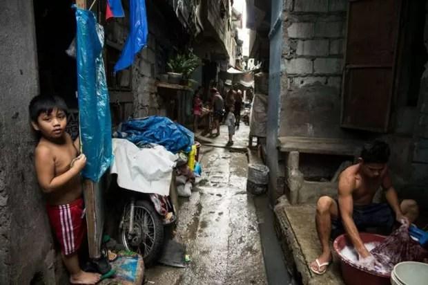 O crime a desigualdade imperam em alguns bairros das Filipinas (Foto: BBC/Jonathan Head)