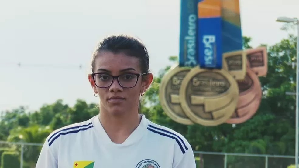 Débora Oliveira quebrou recordes nos 400 metros rasos e no salto em distância — Foto: Reprodução/Rede Amazônica Acre
