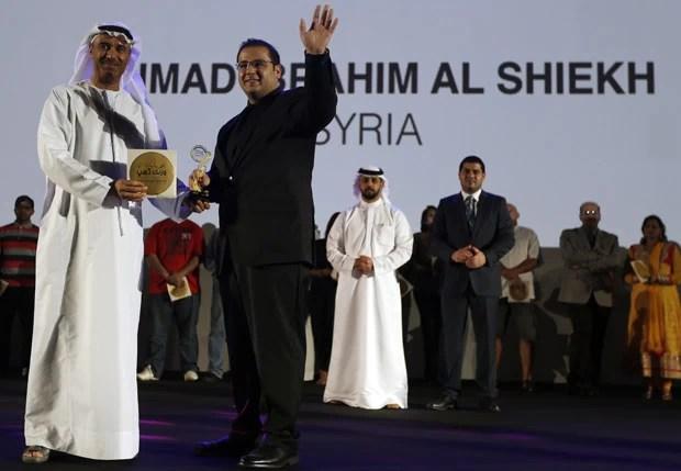 arquiteto sírio Ahmad al Sheikh, de 27 anos e que pesava 146,7 kg, conseguiu um prêmio de US$ 2.738 por ter perdido 26 kg (Foto: Karim Sahib/AFP)