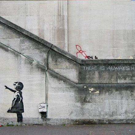 While Banksy makes millions, street artists are going to jail.