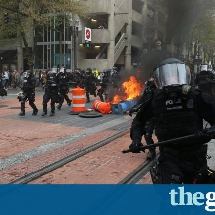 Protesters throw Pepsi cans at police during May Day demonstrations